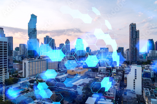 Obraz Hologram of abstract technology glowing icons, panoramic cityscape of Bangkok at sunset, Asia. The concept of worlds technological changes. Double exposure. - fototapety do salonu