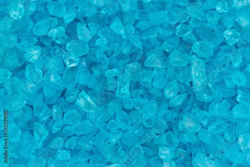 Teal textured beach glass closeup background