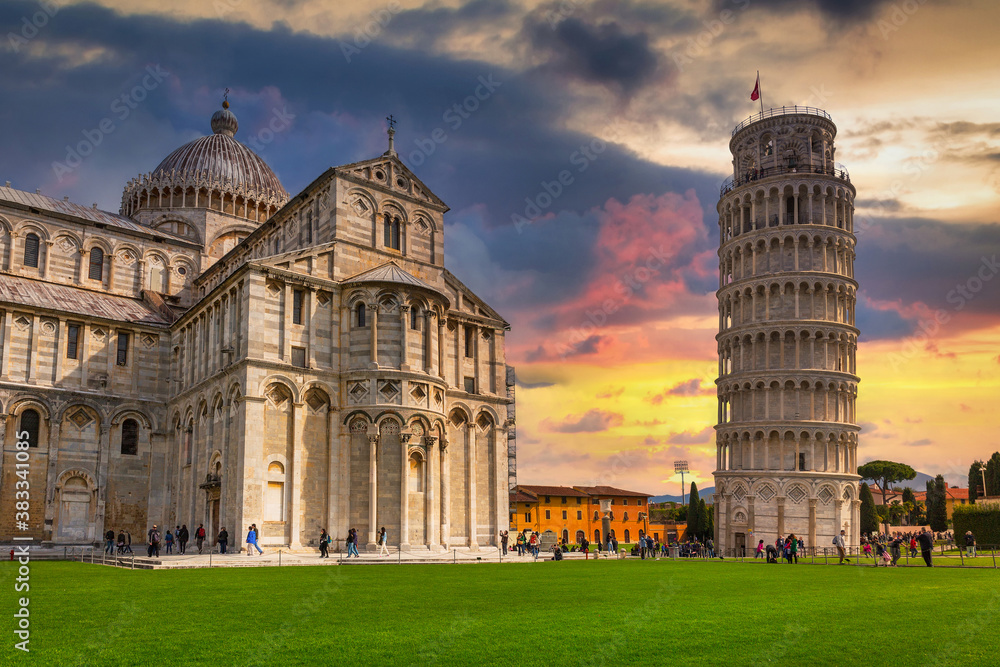Cathedral and the Leaning Tower of Pisa at sunset, Italy biggest landmark.