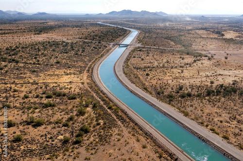 Fototapeta Irrigation canal winding thru the Arizona desert