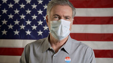 Man With A Mask During Covid In Front Of An American Flag Just Voted