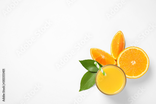Glass of orange juice and fresh fruits on white background, top view
