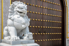 Stone Lion Statue In Front Gate Of Temple. Stone Lion In China. Stone Lion Statue Of Wood Gate.