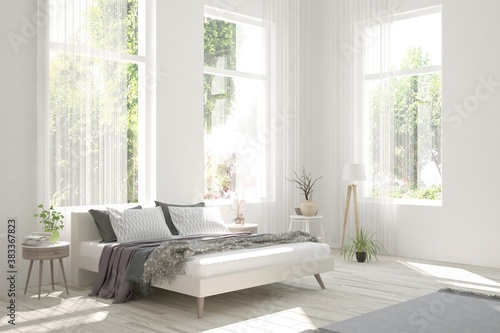 Obraz na plátně Stylish bedroom in white color with summer landscape in window