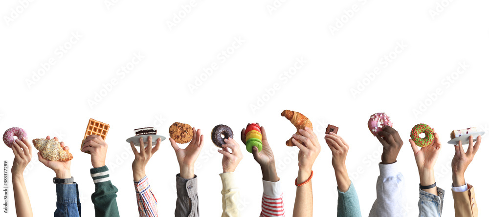 Fototapeta People are holding different desserts in their hands. The concept of food and sweets.