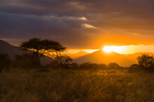 Sunset Over Voi Town And Its Hills From Tsavo Game Reserve, Kenya, East Africa