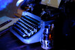 old typewriter on desk, telephone, mystery detective concept, writer's work tools, blue backlight