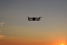 Small Drone In Sky At Sunrise