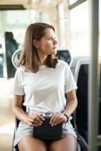 Portrait Of Young Attractive Woman Traveling In Modern Streetcar