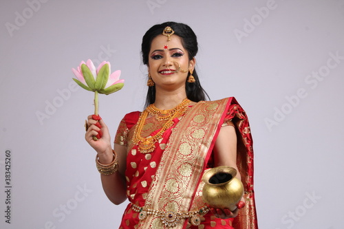 Fotografia, Obraz Indian Godess of prosperity / Lakshmi isolated on white.