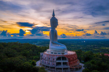Top View Aerial Photo From Flying Drone.Sunset At  Big Buddha Wat Phu Manorom Mukdahan Province, Thailand.