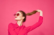 Leinwandbild Motiv Woman in pink shirt and brown glasses cropped view fashion model emotions gesturing hands portrait
