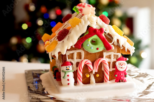 Homemade gingerbread house decorated with icing, sweets , figurines, lollies and Fototapet