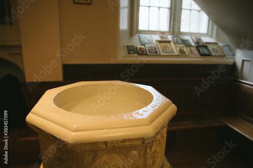 Fotografering baptismal font in an orthodox church