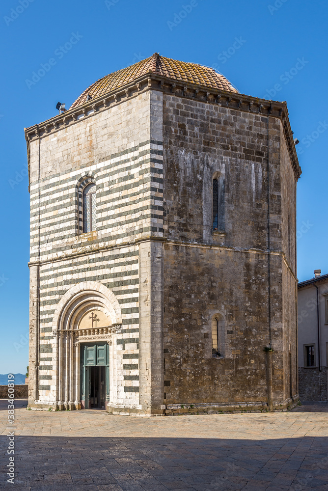 View at the Building of Baptistery of San Giovanni Battista (Saint John the Baptist) in Volterra, Italy