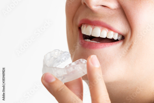 Leinwand Poster Close up on a young woman with beautiful smile while wearing a bruxism bite