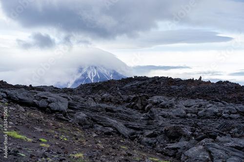 Fototapeta Lava on the background of the Ostry Tolbachik volcano in Kamchatka. obraz