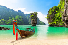 Travel Photo Of James Bond Island With Thai Traditional Wooden Longtail Boat And Beautiful Sand Beach In Phang Nga Bay, Thailand.