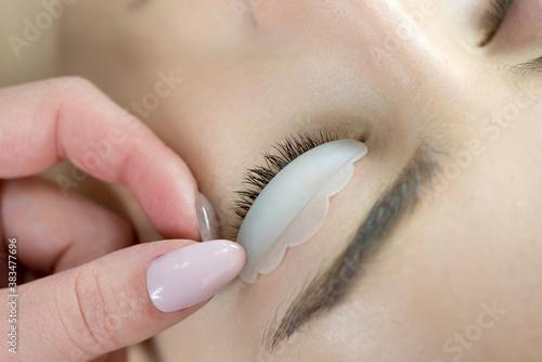 Photo Close up of beauty model's face with perfect fresh skin and long eyelashes, lash lift laminate botox procedure