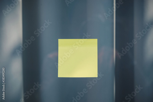 Fototapeta sheets of note papers, stick notes paper, post it on mirror window