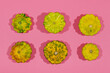 Colorful pattypan squash on pink background. Top view.