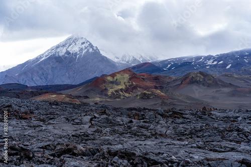 Fototapeta Lava flow against the background of the Ostry Tolbachik. obraz