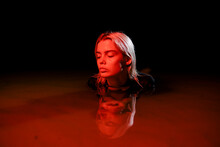 Woman Swims In Red Water At Ni...
