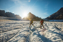Two Hikers Crossing A Large Glacier In Auyuittuq National Park