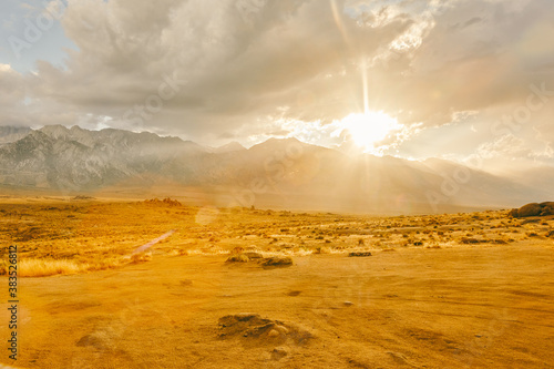 Rays of sunshine near foothills of Alabama Hills during sunset.