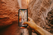 Taking Picture With Phone Of Narrow Slot Canyons In Escalante, Utah