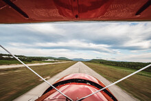 View From Cockpit Of Vintage Plane As It Lands On Runway In Maine