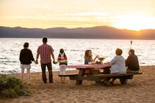 A Family Enjoys A Beach Picnic On The Shoreline Of Lake Tahoe, NV