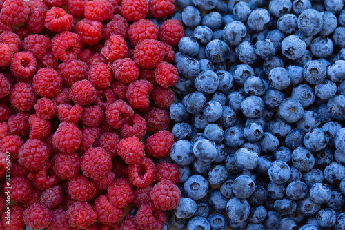 background of raspberries and blueberries Wallpaper Mural