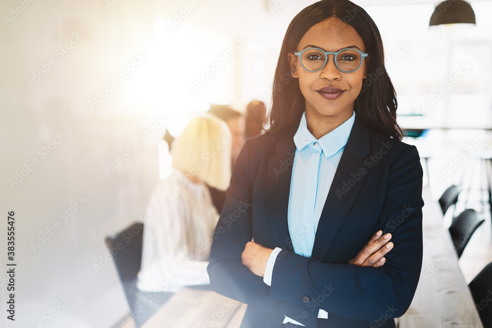 Fototapeta African businesswoman working in a boardroom