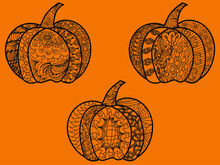 Three Halloween Pumpkins On An Orange Background Decorated With A Subtle Pattern In An Ethnic Style