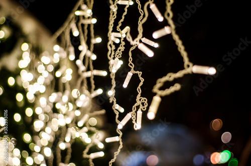 Fototapeta Christmas lights on the christmas tree outdoors, holidays, new year card obraz na płótnie