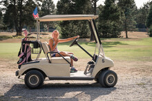 Young Girl Sitting In Golf Car...