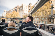Father And Daughter Riding In Double Decker Tour Bus In Barcelona
