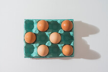 Close-up View Of Raw Chicken Eggs In Egg Box On A White Table
