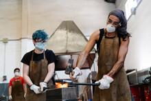 Blacksmiths In Masks Hitting H...