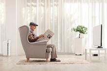 Elderly Man Sitting In An Armc...