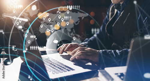 Obraz Male hands with laptop. Man working remotely at home. Concept of networking or remote work. Global business network. Online courses. - fototapety do salonu