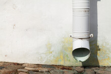 White Drainpipe And Old House ...
