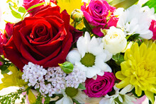 Background Of A Bouquet Of Different Flowers, Different Colors, The Concept Of Birthday, Wedding, Date.