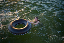 Person Swimming With Inflatabl...