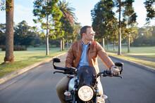 Man Riding Motorbike On Road At Parklands
