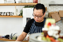 Asian Chef Working In Kitchen ...