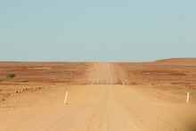 Wide Outback Dirt Road With Bl...
