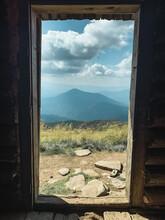 Panoramic View Through Old Door On Carpathian Mountains