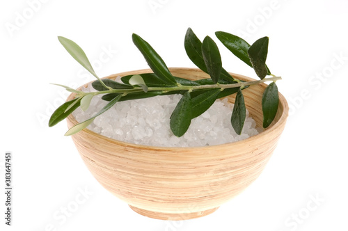 fresh olive branch and bath salt isolated on the white backgroun